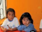 Children finish their lunch at Portal  de Belen day care