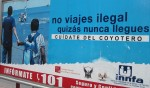 A billboard warns against illegal  immigration