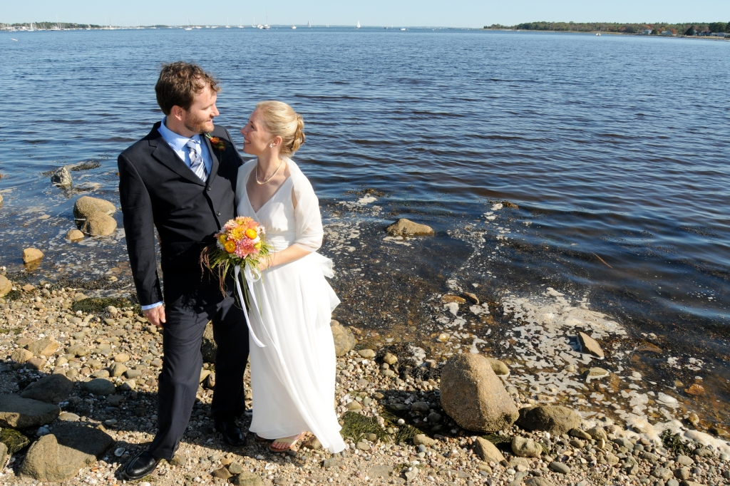 The author and her husband celebrate their wedding beside Buzzards Bay. (Photo courtesy of JCrest Photography)