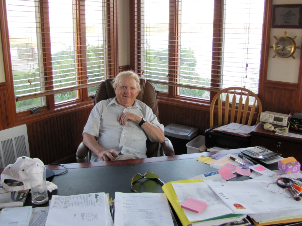 Retired tug pilot Arthur Fournier in his home office (Photo by Becky W. Evans)