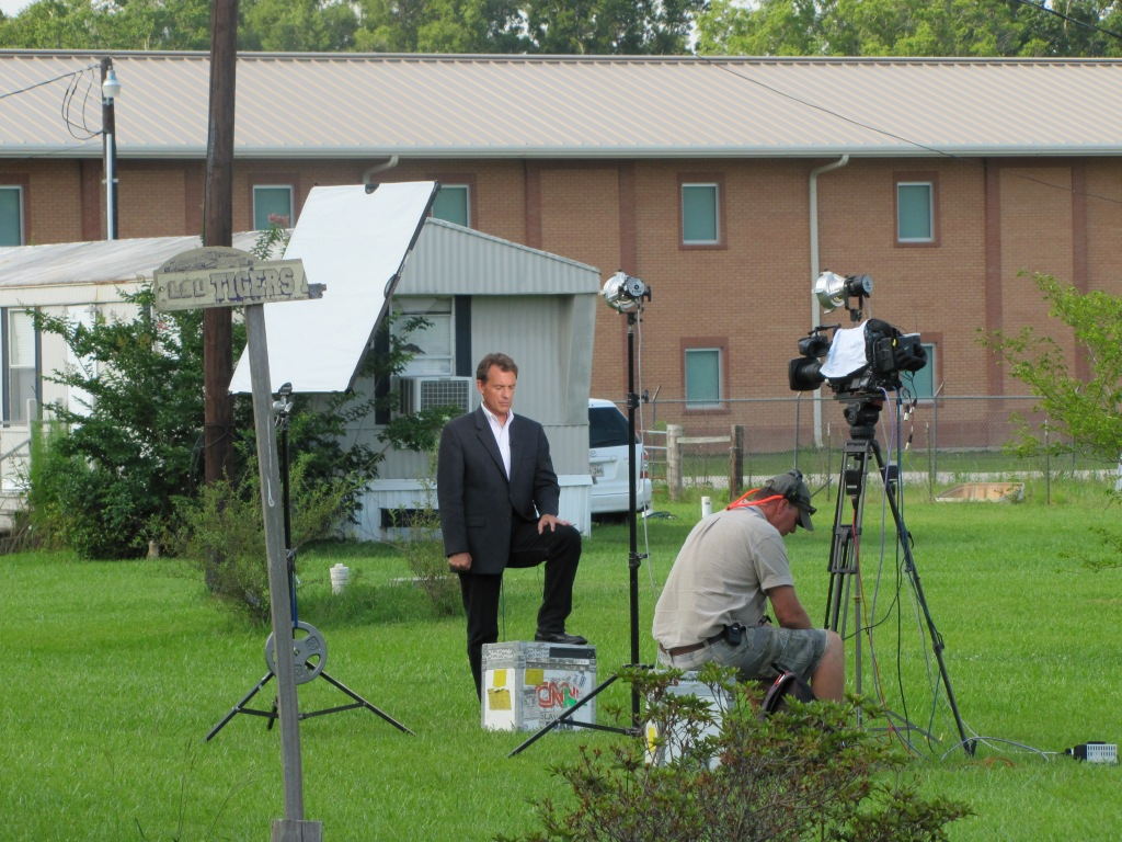 A CNN reporter posing outside the Deep Horizon Response Unified Command Center in Robert, La. (Photo by Becky W. Evans)